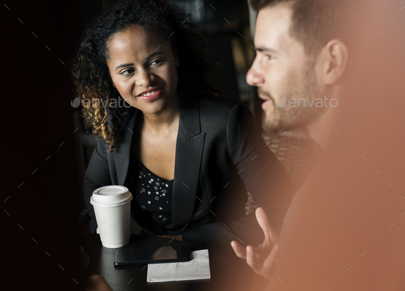 Partners discussing business over coffee - Stock Photo - Images