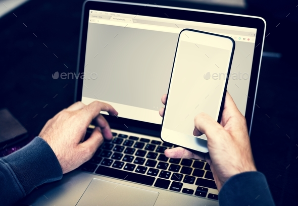 Closeup of hands holdin mobile phone - Stock Photo - Images