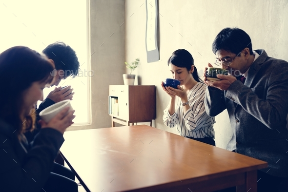 Japanese business people drinking sake - Stock Photo - Images