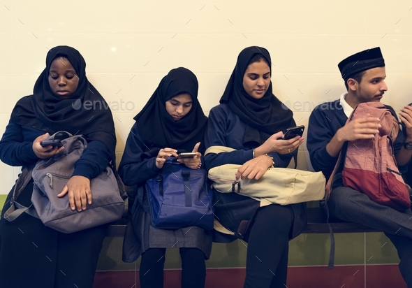 Group of diverse students using mobile phones - Stock Photo - Images
