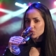 Girl Drinking Champagne at the Party with Lights - VideoHive Item for Sale