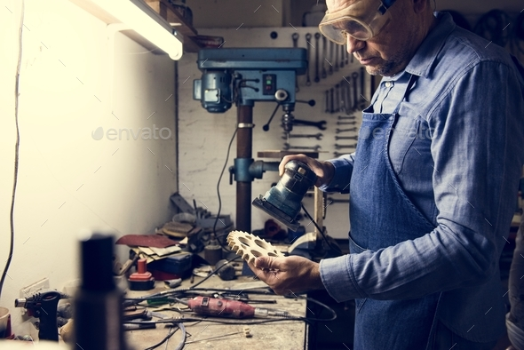 A man is working in a workshop - Stock Photo - Images