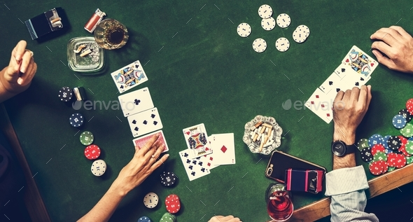 Group of people playing gambling together - Stock Photo - Images