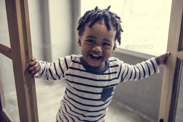 African kid having a fun time - Stock Photo - Images