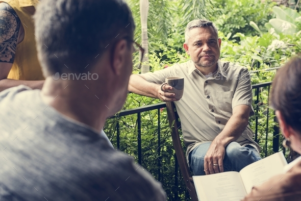 Group of friends are talking together - Stock Photo - Images