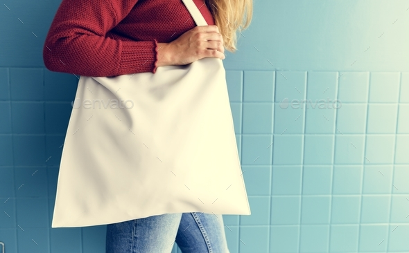 Closeup of woman with white tote bag - Stock Photo - Images