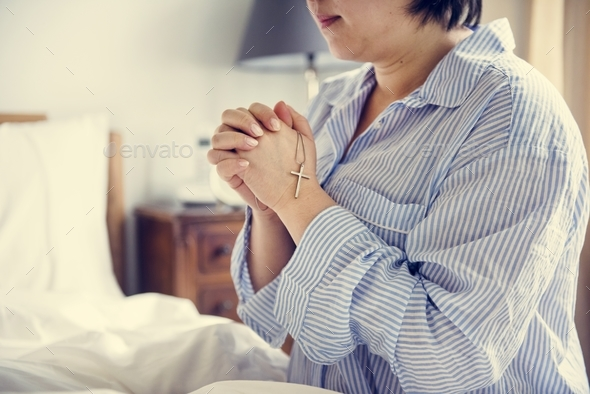 A woman praying - Stock Photo - Images