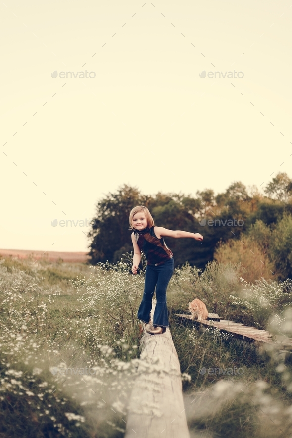 A young girl is having fun in the farm - Stock Photo - Images