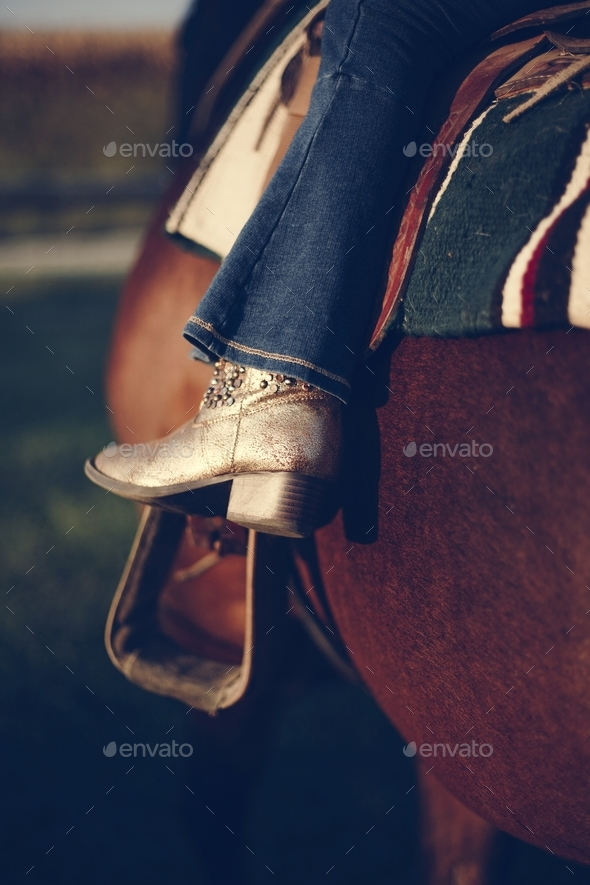 Little girl riding a horse - Stock Photo - Images