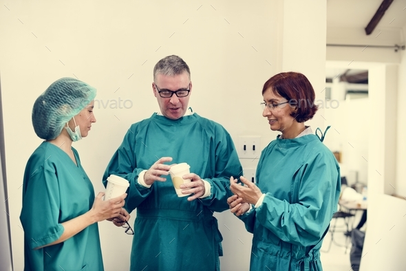 Doctors talking together during break time - Stock Photo - Images