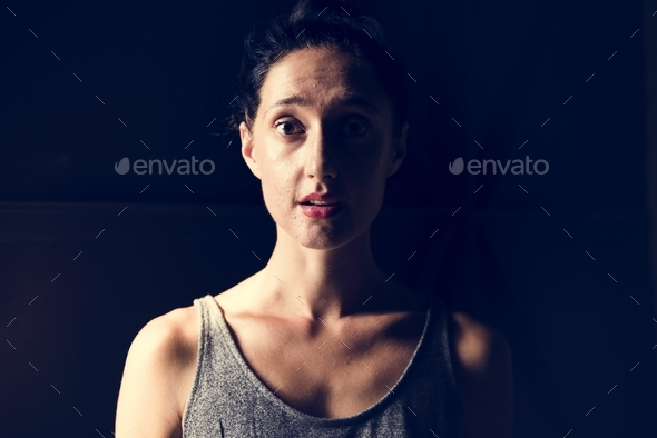 Woman with face expression black background - Stock Photo - Images