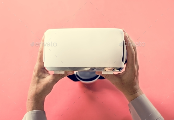 Hands holding VR isolated on background - Stock Photo - Images