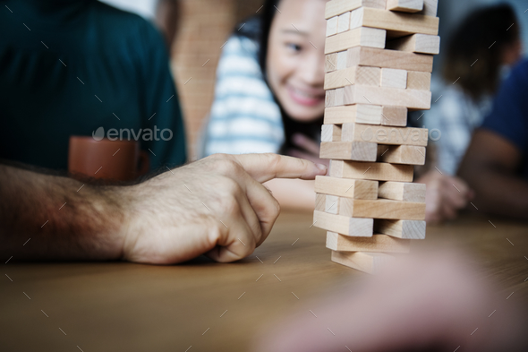 Friends playing game together at home - Stock Photo - Images