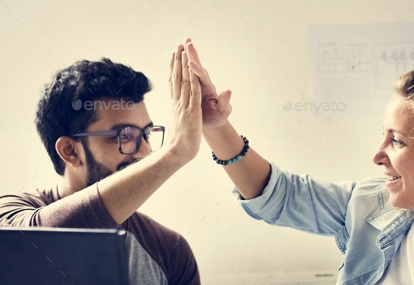 Computer technicians friends hits their palms together - Stock Photo - Images