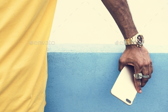African man holding a smart phone - Stock Photo - Images