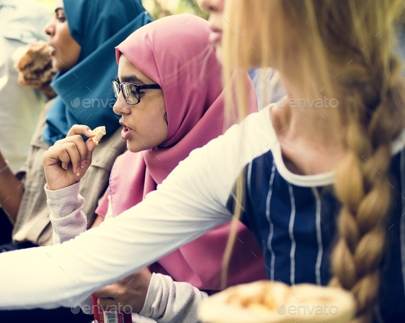 A group of diverse students are having lunch together - Stock Photo - Images