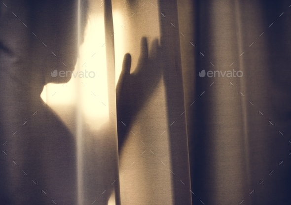 Human shadow behind a curtain - Stock Photo - Images