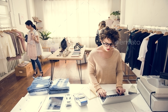 Customers checking out the shop - Stock Photo - Images