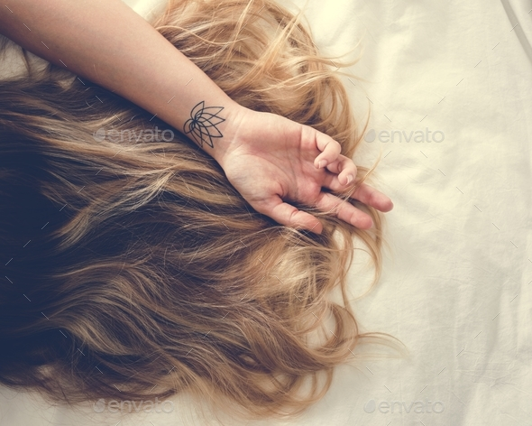 Woman with Brunette Hair Lying Down on the Bed - Stock Photo - Images