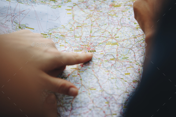 Finding their desitination on a map. - Stock Photo - Images
