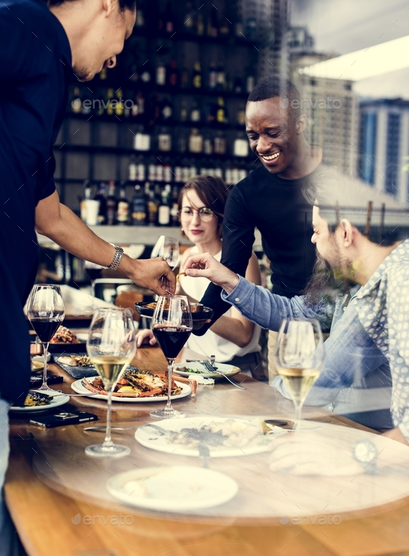 Group of friends in a restaurant - Stock Photo - Images