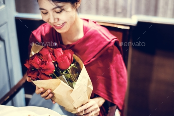 Woman got red rose bouquet - Stock Photo - Images