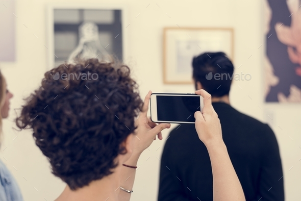people checking out the exhibition - Stock Photo - Images