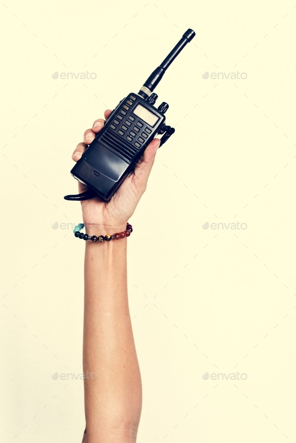 Hand holding portable two way radio isolated on white - Stock Photo - Images