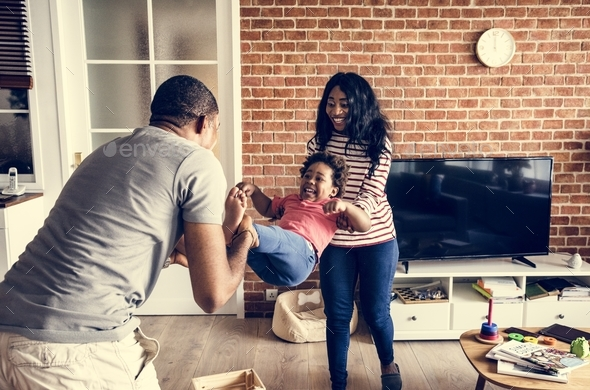 Black family spending happiness time together - Stock Photo - Images