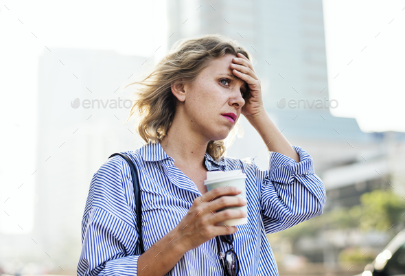 Tensed woman is late for work - Stock Photo - Images