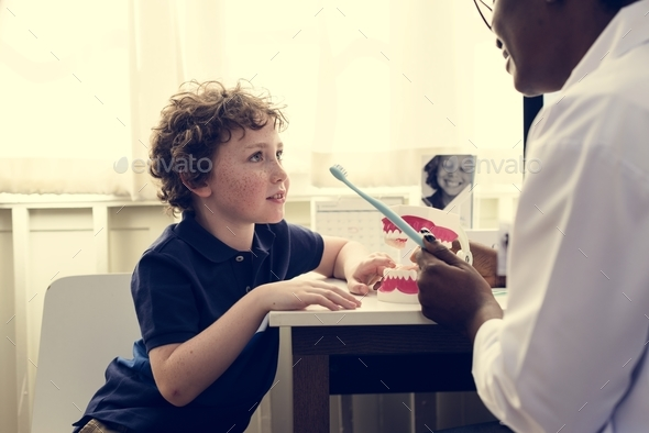 Young boy and his doctor - Stock Photo - Images