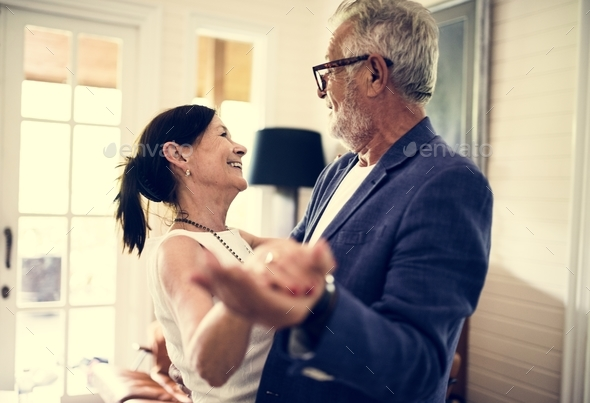 An elderly couple is dancing together - Stock Photo - Images