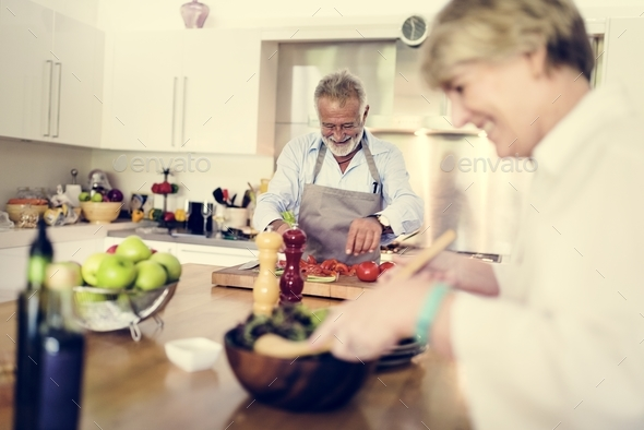 Couple are cooking in the kitchen together - Stock Photo - Images