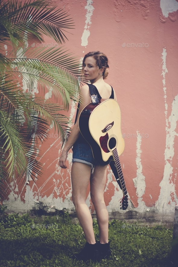 Beautiful guitarist woman with guitar classic - Stock Photo - Images