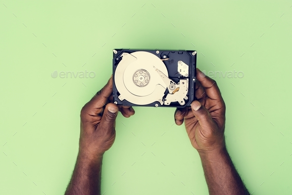 Hands holding Hard disk drive data backup isolated on background - Stock Photo - Images