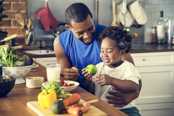 Dad and son cooking together - Stock Photo - Images