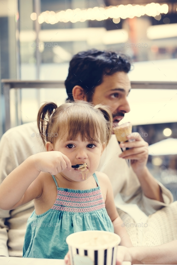 Family eating ice-cream together - Stock Photo - Images