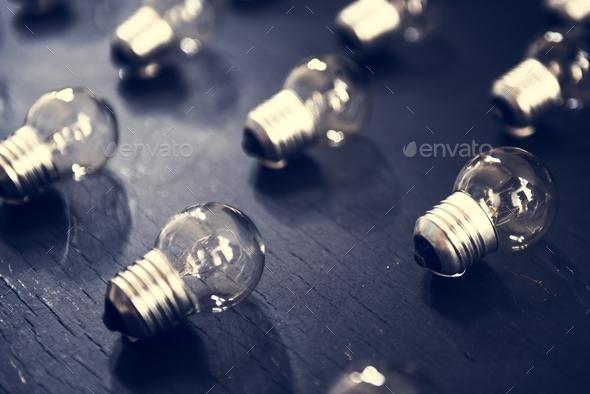 Lightbulbs on black textured table - Stock Photo - Images