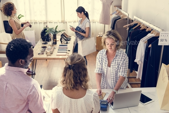 People checking out clothes - Stock Photo - Images