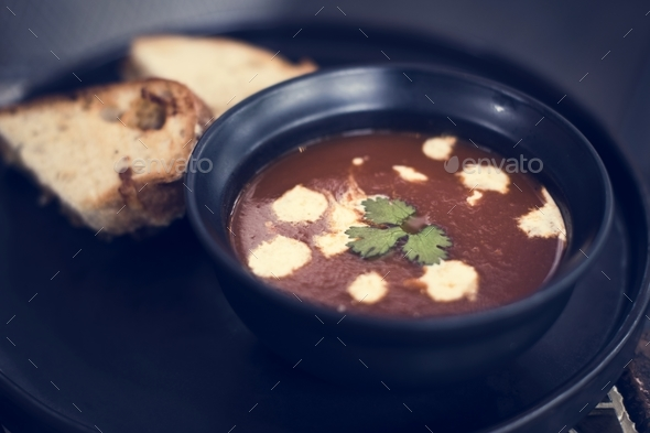 Warm tomato soup bowl and bread - Stock Photo - Images
