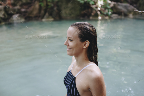 White woman enjoying the waterfall - Stock Photo - Images