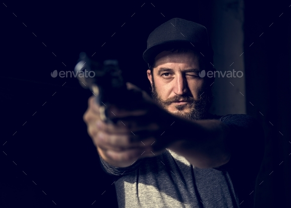 Man golding shot gun shooting - Stock Photo - Images