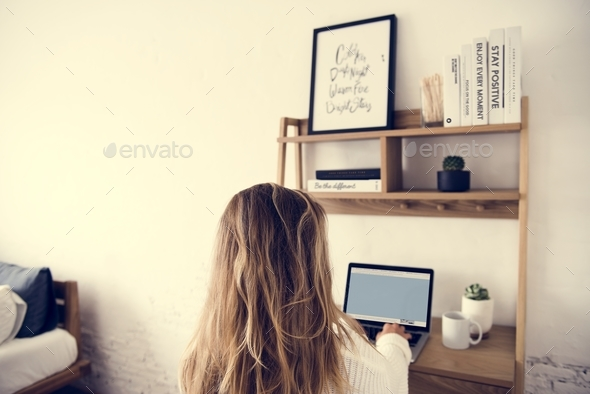 Caucasian woman using laptop on the desk - Stock Photo - Images