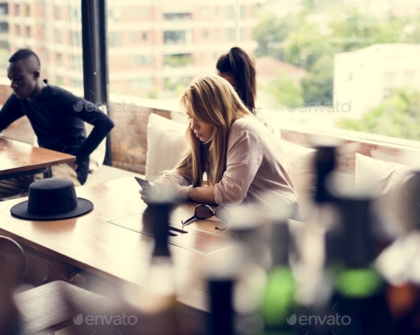 A young woman in a restaurant - Stock Photo - Images