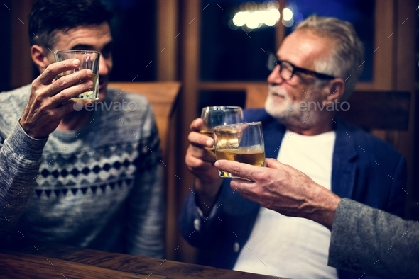 Two friends having a drink together - Stock Photo - Images