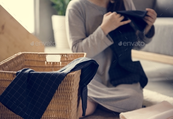 Japanese mother folding clothes - Stock Photo - Images