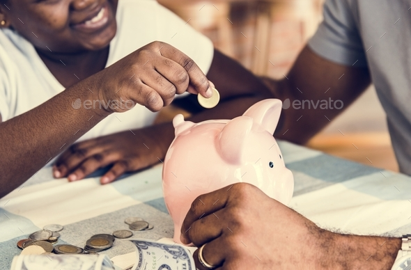 Dad and daughter saving money to piggy bank - Stock Photo - Images