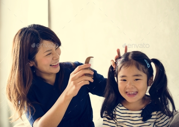 Cheerful japanese mother and daughter - Stock Photo - Images