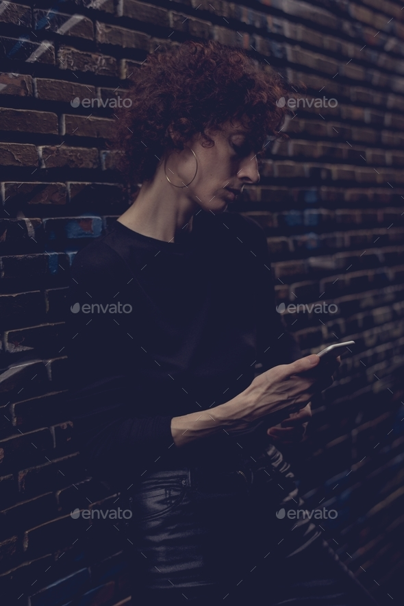 Woman looking at her phone - Stock Photo - Images