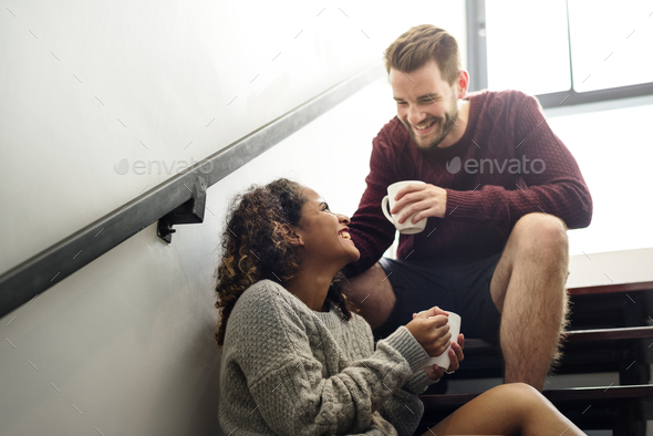Cheerful young couple is talking - Stock Photo - Images